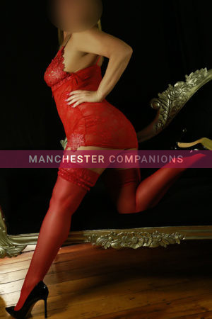 Kimberley wearing red lace underwear, red stockings and heels