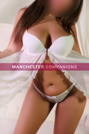 Layla wearing a pretty white baby doll and matching thong